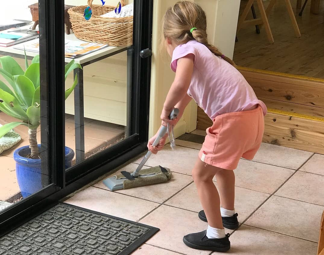 Mopping the floors at the end of the day is a part of Montessori chores.