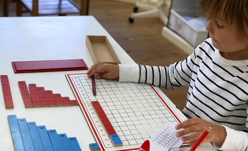 Photo of a student exploring mathematics materials.