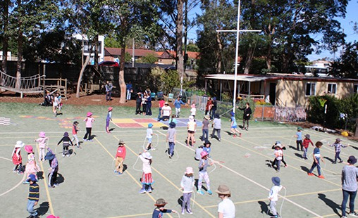 Photo of students jumping rope on FMS's sports oval.