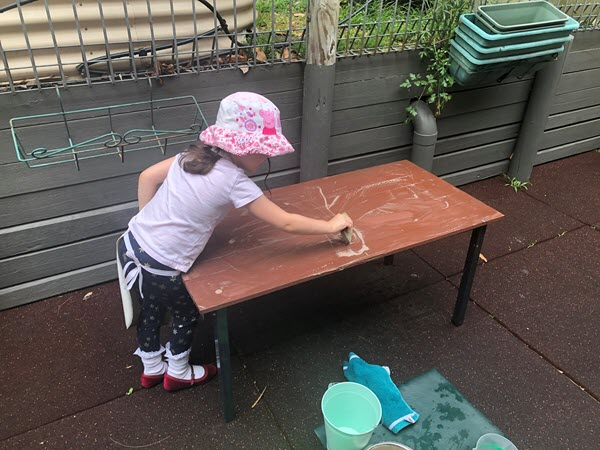 Pre-Primary - cleaning a table