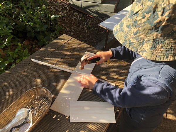 Pre-Primary - using hammers outside