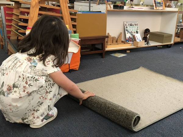 Pre-Primary - rolling up a mat